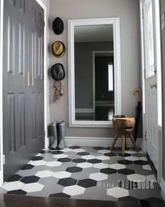 A Front Foyer makeover – Before & After. A modern yet youthful design using pattern tile in black, white, grey | pink little notebook