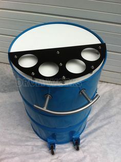 Recycled 55 gallon steel drum made into portable bar. Powder coated in Panther colors of teal with white, black and silver accents. Has casters to roll about on your deck, in your home or at the big game tailgate party. Touchdown!: