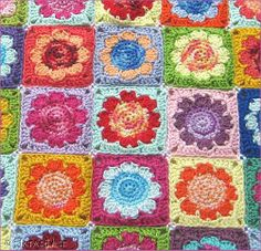 "Free pattern for ""Daisy Granny Blanket""...love the variegated yarn in the center of flowers!"
