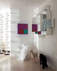 A Mod Mirror - A Van der Straeten mirror hangs in the entry of a Manhattan home designed by Robert Couturier - from Elle Decor Web Design, House Design, Appartement Design, Mid Century Modern Design, Neon, Apartment Living, Apartment Entry, Elle Decor, Decoration