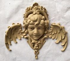 "It is a pleasure walking through the factory and seeing the (if you don't mind my saying so !) beautiful castings we ship all over the country (and some overseas). The original carving in our vault was carved between 1900 and 1920. This particular piece is from the Louis XV period and is 9 1/8"" x 8 1/2""."