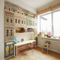 This is by far the cutest kid room ever! I'm loving the city look as a shelf/storage area! And the cute desk is to die for!