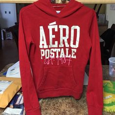 Good condition hoodie sweatshirt Red , long sleeve ,with hoodie  two small little rips , can be stiched !!! No stains Aeropostale Jackets & Coats Utility Jackets