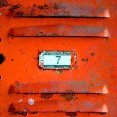 Lucky Locker Seven. Orange. Seven. Rusty.