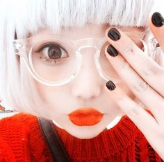 Cute white hair bob with clear glasses and red lipstick.