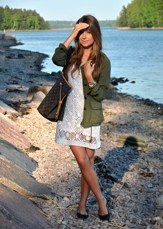 White lace crochet dress + olive utility jacket + Louis Vuitton Neverfull tote