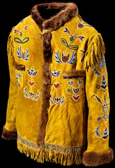 Tsuu T´ina (Sarcee) coat  ca. 1890  Probably Canada  Deer hide, cotton cloth, otter fur, glass beads, ochre  73 x 118 cm  Mrs. Edwin C. Ward Collection  11/4236