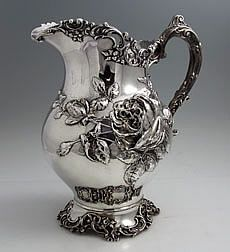 Fuchs Sterling Antique Pitcher.  An unusual finely chased pitcher by Fuchs with a large chased rose and rose buds decorating the body, dated 1898.