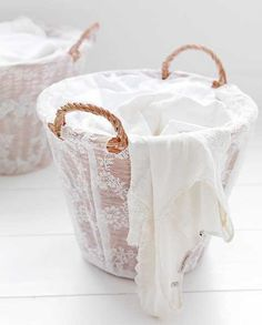 A pretty laundry basket with lace covering.