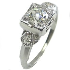 Fan Dancer: A dazzling old mine cut diamond shimmies and shines from every angle in this flirty solitaire. Openwork fan detail cinches in at the shoulder, enhancing the voluptuous proportion of the plump center stone. Maloys.com