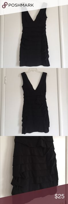 Little black dress Deep v neck, form fitting, curve accentuating dress. 95% polyester, 5% spandex. Slight loss of stitching (pictured) but not noticeable when on. Tiny hole (size of the tip of a pen) on the right lower corner. Very comfortable and stretchy. grass collection Dresses Mini