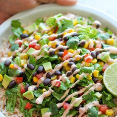 Easy Burrito Bowls Recipe Main Dishes with rice, salsa, romaine lettuce, whole kernel corn, drain, black beans, roma tomatoes, avocado, coriander leaf, sour cream, chipotle paste, garlic, lime, salt