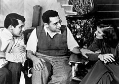Cary Grant (left) and Katherine Hepburn share a moment with famed director George Cukor (Adams Rib, The Philadelphia Story, Little Women, etc.)