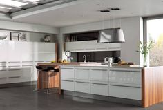 Machair Collection High-gloss white fitted kitchen with contrasting matt walnut wood worktop for added wow-factor. Personalise your design with our range of ultra-modern accessories