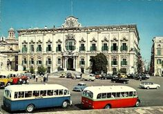 city buses..The red bus was the Zejtun Line and the blue bus was the Gudja-Ghaxaq Line