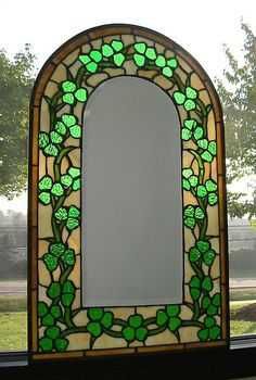 """""""Stained Glass Shamrock Mirror: Crafted in the Tiffany-style, copperfoil method, this shamrock-framed beveled mirror is a masterpiece of light and color. Textured translucent and opaque glass in shades of green and cream."""""""