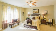 A spacious and bright master bedroom.