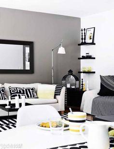 Mustaa, valkoista, harmaata ja keltaista. Hallitulla väripaletilla saat tyylikkään kodin. Poimi parhaat sisustusvinkit!
