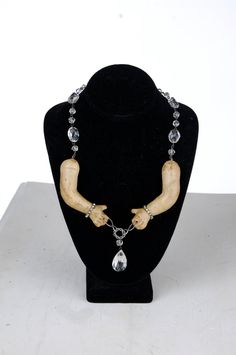 Avant Garde Macabre antique french crystal baby doll arm necklace. $90.00, via Etsy.