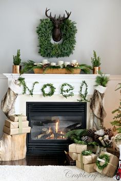 LOVE this mantel with these boxwood holiday words!!!