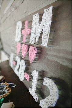 Create unique nail art for your wedding using nails and yarn to spell out your wedding initials. Photo: J. Nichols.