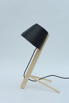 """The """"laid back"""" Pine Lamp by up-and-coming Danish design firm MadeByWho is either a desk or floor lamp made of pine."""