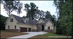 3,162 Sq Ft home with 4 bedrooms, 3.5 bathrooms.  Courtyard style garage. Outdoor living spaces include a screen room, upper patio, and lower patio with curved brick staircase.