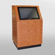 "MKCS-30 Kiosk in Brown Cherry Finish. This kiosk is designed around a Cybertouch 24"" wide touch screen monitor. Ventilation and rear access to the equipment inside is provided by a locking access panel. We can build a kiosk for any sized monitor and house equipment in racks or on shelves. This kiosk is on casters and can be ordered on levelers as you wish. #Kiosk #Custom #Infocomm2012"