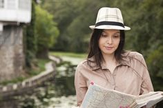 Travel girl looking at the map by pruden.alvarez on Creative Market