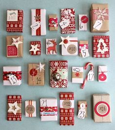 These packages created for Advent really showcase the simple theme of red and white with kraft paper, twine and stars, snowflakes and other iconic Christmas images for a beautiful look~