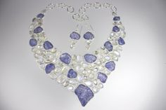 Tanzanite in the rough, moonstones set in sterling silver. Soft periwinkle colors of the tanzanite next to the flashes of blue moonstone make this a very showy set!