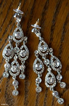 Bride's crystal chandelier earrings add high style to the day