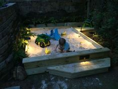 Custom sandbox, with storage and mini-deck, LED lighting. Requires 44 bags of sand. Sandbox portion is x Built in 2 days on the weekend. Kids Outdoor Play, Outdoor Play Areas, Backyard For Kids, Outdoor Fun, Kids Yard, Sand Pit, Backyard Playground, Cool House Designs, Outdoor Projects
