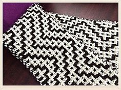 Chevron is all the rage right now. I created this scarf to add a little dimension to the plain chevron. A little white window frames the dark color as the white zigs and zags the length of the scarf. Choose high contrast colors to get the best effect.