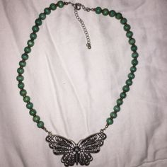 Butterfly wooden beaded necklace Super cute lightweight butterfly necklace. Adjustable clasp. I already have a bundle deal set up for orders but with the necklaces if you have multiple you would like contact me with offers! Jewelry Necklaces