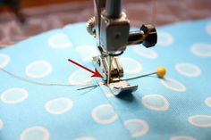 The best zipper tutorial I've seen. She uses scotch tape to hold down the zipper instead of pins-- genius!