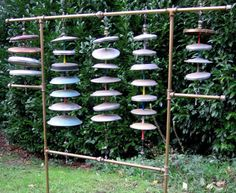 The Aquaggaswack - a large pot-lid bell tree built by Curtis Settino of canoofle.com where you will find audio files of this and other homemade instruments.