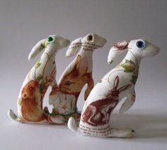 3 Hares wearing rabbits and hares. Hmmm?