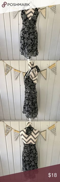 B. Darlin Black & White Floral Halter Dress This gorgeous flowy halter Dress from B. Darlin is in very good condition. It is black and features a white rose print all over. The dress is tight on my mannequin. When I zipped it, the area around the bottom of the zipper kind of dimpled in (see last pic). It went back to normal when I took it off of the mannequin. I am pointing this out because it may dimple on you when worn. The size is 3/4. B Darlin Dresses