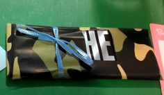 Camo theme baby boy baby shower Hershey bars with camo wrapping paper and blue ribbon with the word he cut out for favors on the tables Camo Wrapping Paper, Hunting Baby Showers, Baby Shower Camo, Sprinkle Shower, Baby Gender Reveal Party, Camo Baby Stuff, Reveal Parties, Blue Ribbon, Military Fashion