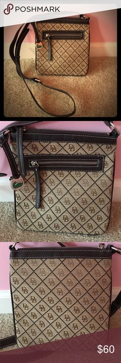 Downey & Bourke Small Cross Body Bag Beautiful brown and tan bag, excellent condition, only used once. 9.5 in. x 8.5 in. with a strap that adjusts from approximately 50 in.  to 55 in. Adorable green duck charm attached. Smoke free home. Dooney & Bourke Bags Crossbody Bags