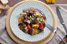Cherry tomato salad with fresh figs, pine nuts, blue cheese and basil chiffonade