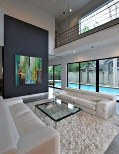 like the white room with large colorful art and a pool outside !!