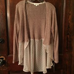 Adorable Cardigan! Super cute cardigan!.  Sheer cream polka dot pattern at bottom.  Hi-lo. Pair over a tank or under another sweater.  Great piece for the fall!  Big on the arms for me because I'm an xs/s. Taylor & Sage Sweaters Cardigans