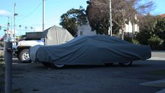 Lincoln Continental under blanket at Garage 77 in Los Angeles Lincoln Continental, Outdoor Gear, Bean Bag Chair, Tent, Garage, Blanket, Cars, Pictures, Carport Garage