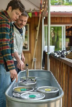 DIY bartender - kegs! From Allie & Marko's DIY, colorful Virginia farm wedding. images by Bryan John Photography.