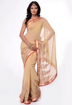Light beige faux chiffon zari and patch border saree. Matching blouse is available with this, blouse shown in this image is photography purpose. (Slight variation in color and patch border is possible.) data-pin-do=