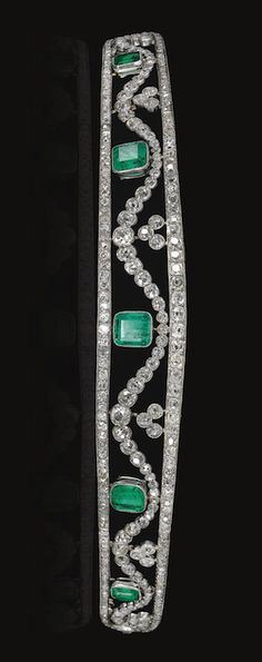 EMERALD AND DIAMOND TIARA, CHAUMET, CIRCA 1910 Of tapered bandeau design, the frame set with rose, circular-cut and cushion-shaped diamonds, embellished with five collet millegrain-set step-cut emeralds, to a garland of cushion-shaped and circular-cut diamonds, circumference approximately 210mm, unsigned, fittings, case signed J. Chaumet, Sr de Morel & Cie, London, New Bond Street, 154, Paris, Place Vendôme, 12.