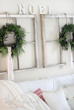 Paired windows with wreaths