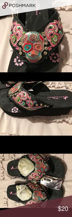 Sugar Skull Flip Flops Montana West sugar skull flip flops. These have about a 2 inch heel on the back. Very cute and easy to walk in. Montana West Shoes Sandals